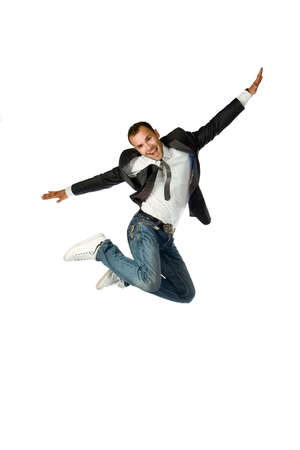 boy jumping: El feliz hombre de negocios de saltar sobre un fondo blanco