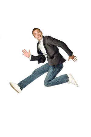 ni�o saltando: El feliz hombre de negocios de saltar sobre un fondo blanco