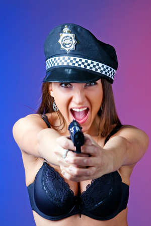 Sexy attractive woman with gun Stock Photo