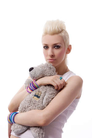 A beautiful girl with a Teddy photo