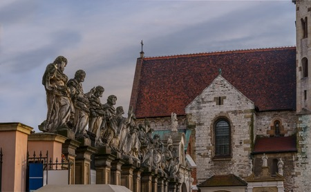 saints peter and paul: Statues of 12 apostles. Roman Catholic Church of Saints Peter and Paul in Baroque style. Old Town district of Krakow Stock Photo