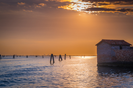 san giacomo: Old abandoned building of San Giacomo in Paludo island in Venice lagoon at sunset, Italy.