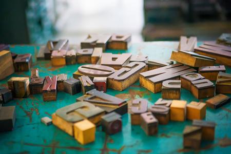 wooden letters on the table designer inside