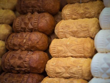 oscypek: Traditional polish smoked cheese oscypek in Zakopane, Poland Stock Photo