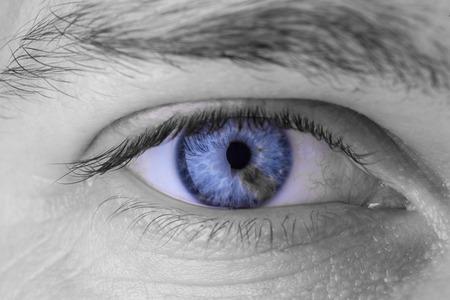 The piercing male gaze, blue eyes with grey specks. Stock Photo