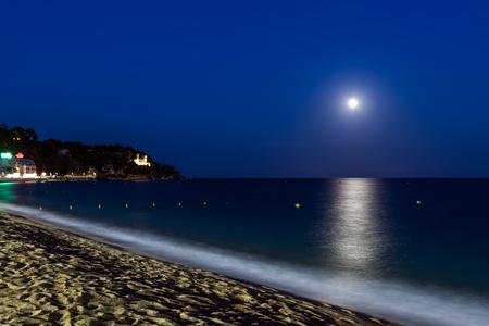 Lloret de Mar night scene moon over the sea. Catalonia, Spain. Stock Photo