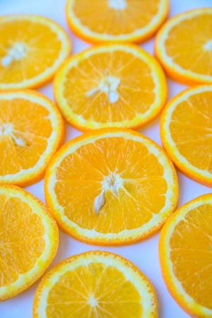 Background of round slices of orange orange