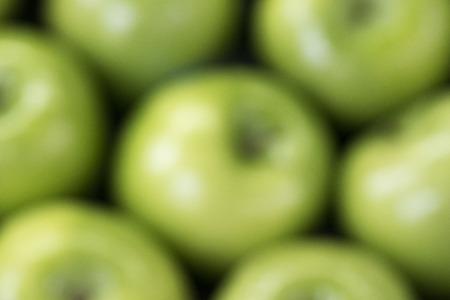 green fresh apples for background in full blur Unsharp