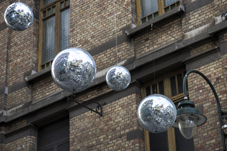 Christmas street decoration in the form of large shiny strobe balls