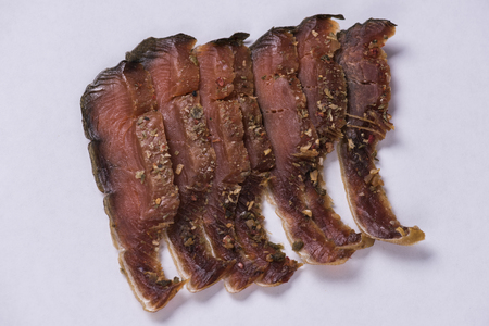 isolated pieces of dried fish with red meat of pink salmon Foto de archivo