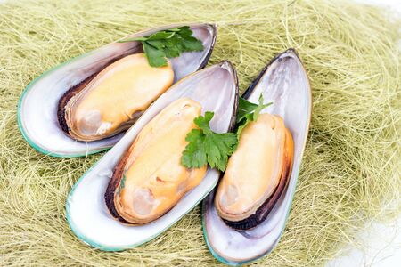 Boiled large mussels with parsley.