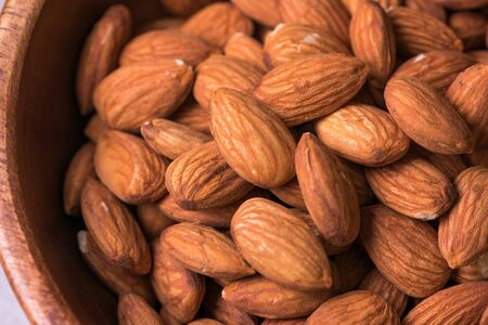Close up. almonds in a wooden bowl