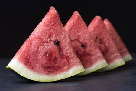 pieces of ripe red watermelon on the table