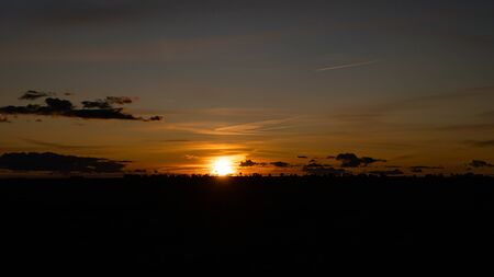 Summer sunset over a rural field. Stok Fotoğraf