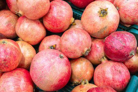 Pomegranates close-up on a shop window Foto de archivo