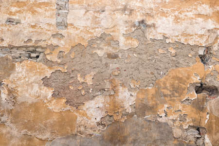 shabby plaster on an old wall photo