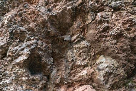 weathered rock texture. cliff background Zdjęcie Seryjne