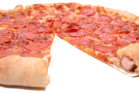 Pizza with a sideboard close up on a white background