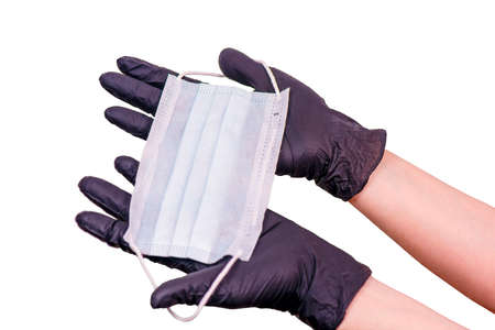 female hands in gloves hold a mask. coronovirus pandemic