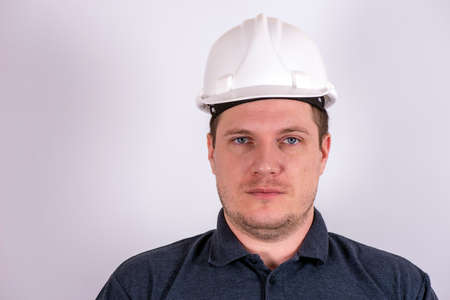white male engineer in a white hard hat