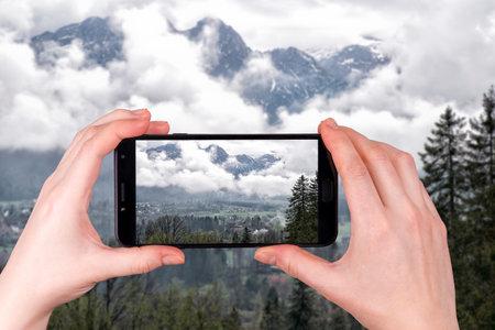 on the town of Zakopane against the background of the Tatra mountains, Zakopane, Poland. tourist takes a photo