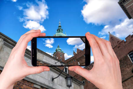 famous Wawel cathedral Krakow, Poland. tourist takes a photo Фото со стока