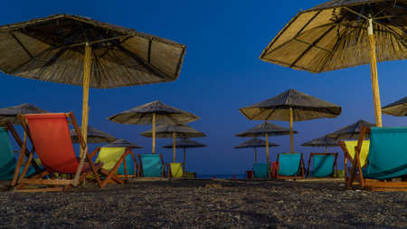umbrellas at dusk on the beach at night