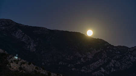 rising moon over the mountain