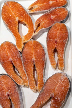 pieces of chilled red salmon fish lie on ice Stok Fotoğraf