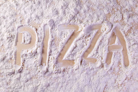 inscription on the kitchen board on the flour pizza