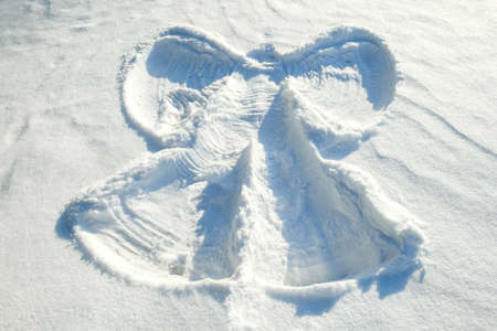 angel in the snow. childrens fun in the snow