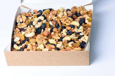 healthy food. box with nuts on a white background