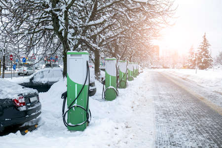 refueling for electric vehicles in winter. ecological chargers for cars with electricity