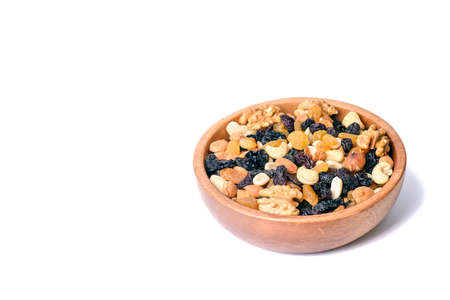 healthy food. bowl with nuts isolated on white background