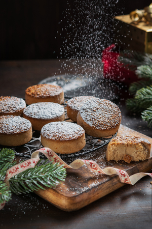 Traditional Christmas cookies with almonds and sesame on dark wooden background with copy space. Vertical. Close up. Christmas and New Year celebration concept. Holiday decoration. Stok Fotoğraf