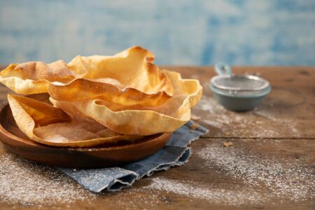 Papadum or papad traditional indian food, vegetarian bread from lentils or beans. Food popular in Nepalese, Pakistani, Sri Lankan, Indian and Bangladeshi cuisines. Space for text. Stock Photo