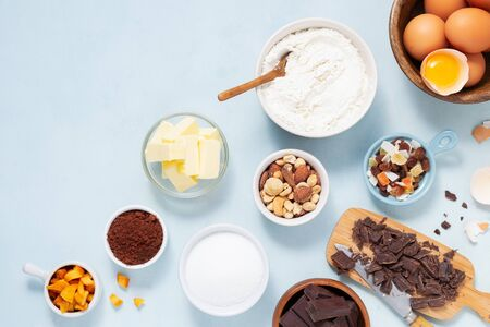 Dough preparation recipe cake, brownie, muffins, cupcakes ingridients, food flat lay on light background. Working with butter, chocolate, cocoa, flour, eggs, fruits, nuts, bakery cooking Text space