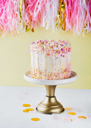 Colorful birthday cake with sprinkles on a yellow background with copyspace. Party concept. Mother's Day, Birthday Cake card Banner. Selective focus. Imagens