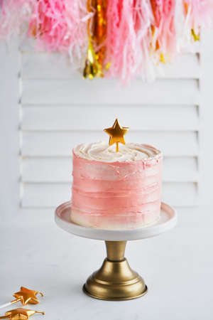 Birthday pink cake with star cake topper candles on a white background with space for text. Romantic Party concept. Mother's Day, Birthday Cake card Banner. Selective focus.