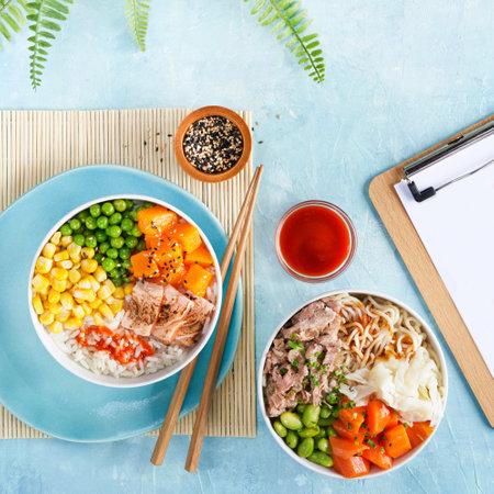 Hawaiian Poke bowls flamed salmon, pulled pork, rice, noodles, baek kimchi, pumkin green peas, sweetcorn, sesame seeds. Turquise surface. Top view, trendy food, Restaurant menu. Copy space.