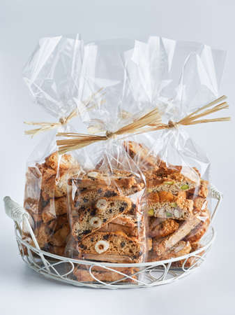 Assorted Biscotti Cantucci Biscuits Cookies in plastic wrap packaging for sale. Italian dessert cookies close up, selective focus, space for text. Homemade bakery confectionery concept for sale. Foto de archivo