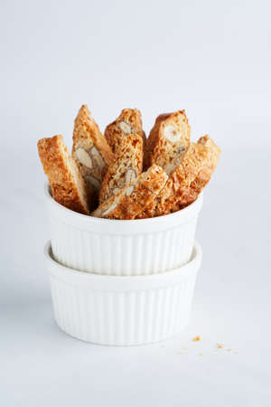 Italian Almond Biscotti Cantucci Biscuits, italian dessert cookies close up, selective focus, space for text. Homemade bakery confectionery concept.