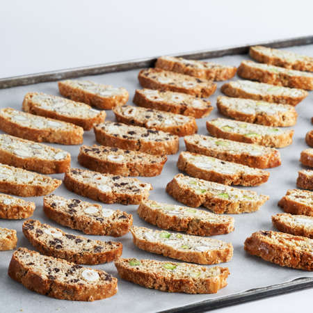 Assorted Biscotti Cantucci Biscuits, italian dessert cookies close up, selective focus, space for text. Homemade bakery confectionery concept.