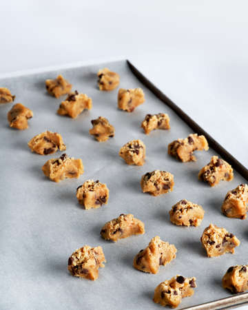 Chocolate Chip cookies on baking sheets. Close up, selective focus, homemade dessert bakery concept.