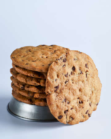Big Soft and Crumbly Chocolate Chip Cookies. Close up view, selective focus, space for text. Sweets for sale in supermarket. Natural and proximity products. Foto de archivo