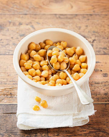 Cooked Chickpeas on a bowl wooden rustic background. copy Space, selective focus. Nutrition, Healthy, vegetarian food concept.