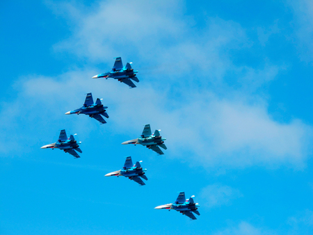 Six military fighter jets during demonstration