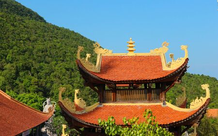 Ornate roof of buddhist temple.  Oriental religious architecture.