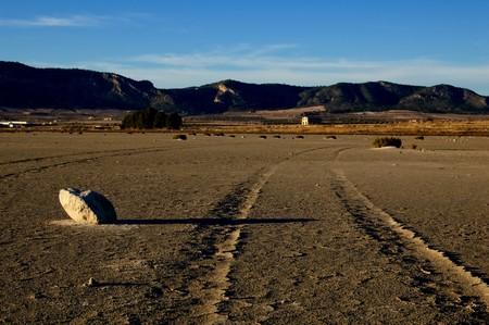 Dry salt lake - desert landscape, trace of tyres detail - Laguna de Salinas (Spain) photo