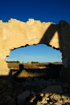 hole in the wall with landscape photo
